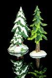 Cumprimente árvores do brinquedo com neve nelas fotografia de stock