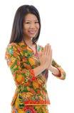 Cumprimento asiático do sudeste da menina Foto de Stock