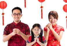 Cumprimento chinês da família Imagens de Stock