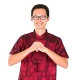 Cumprimento chinês do homem Fotos de Stock Royalty Free