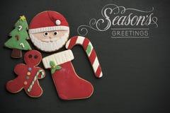 Cumprimentos das estações das cookies e do texto do Natal Fotografia de Stock Royalty Free