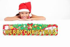 Cumprimentos do Natal da menina imagem de stock royalty free