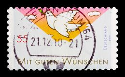 Cumprimentos: A paz mergulhou, cumprimentando o serie dos selos, cerca de 2010 Fotos de Stock Royalty Free
