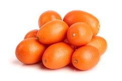 Cumquat或金桔在白色背景关闭 免版税图库摄影