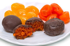 Cumquat  and chocolate candies Royalty Free Stock Image