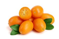 Cumquat or kumquat with leaf isolated on white background close up Royalty Free Stock Photo