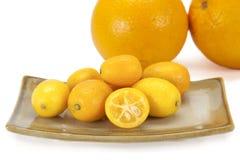 Cumquat lub kumquat na białym tle Zdjęcie Stock