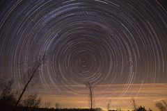Cumulative time lapse of star trails in night sky. Cumulative time lapse of star trails in night  sky Stock Photography