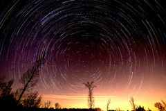 Cumulative time lapse of star trails in night sky. Cumulative time lapse of star trails in night  sky Stock Photo