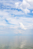 Cumuli white clouds and calm water Sea of Azov. Natural background - cumuli white clouds and calm water Sea of Azov, Temryuk bay, Golubitskaya resort, Taman Stock Image