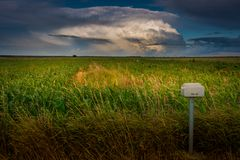A beautiful giant cumulonimbus over the fields. stock image