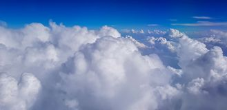 Cumulonimbus cloud above sky view from airplane. White and blue cumulonimbus cloud above sky view from airplane Royalty Free Stock Images