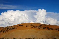 Cumulonimbus cloud. Blue sky with ornamental clouds Stock Photos