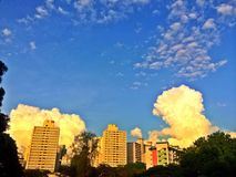 Cumulonimbus clouds above residential buildings Stock Image