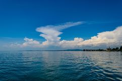 Clouds over Lake Constance. Cumulonimbus Clouds over the shore of the lake can be signs of an emerging Thunderstorm Royalty Free Stock Image