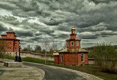 Cumulonimbus clouds over a small orthodox chapel Royalty Free Stock Images