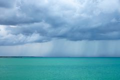 Cumulonimbus clouds over the turquoise sea Stock Photography