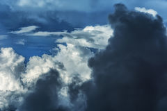 Cumulonimbus Clouds. Thick cumulonimbus clouds shot from inside an airplane Royalty Free Stock Images