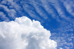 Cumulous and Stratus. A large cumulous cloud with wispy stratus beyond stock photos