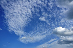 Cumulus and Altocumulus Clouds Stock Images