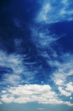 Cumulus and cirrus clouds on a sunny day Royalty Free Stock Photos