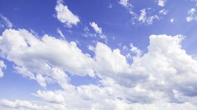 Cumulus cloud background. Cumulus clouds against blue sky background stock photos