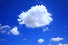 Cumulus cloud in clear blue sky. A puffy Cumulus cloud floating in a rich blue sky Stock Images