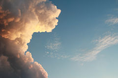 Cumulus cloud illuminated, and blue sky Royalty Free Stock Photography