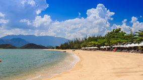 Cumulus cloud motion over hilly island beach azure sea. Fantastic cumulus cloud motion over hilly tropical island azure sea and golden beach in Vietnam stock video footage
