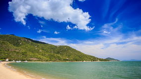 Cumulus cloud motion over hilly island beach azure sea. Fantastic cumulus cloud motion over hilly tropical island azure sea and golden beach in Vietnam stock video