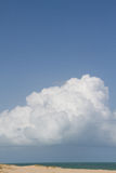 Cumulus cloud with ocean and beach Stock Photography
