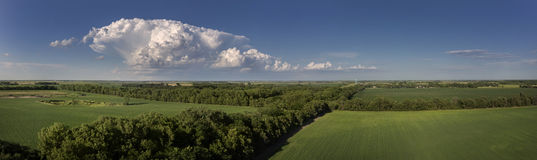 Cumulus Cloud Panoramic. A Cumulus cloud floating over the Midwest coutryside in South Dakota on a Summer evening Royalty Free Stock Images