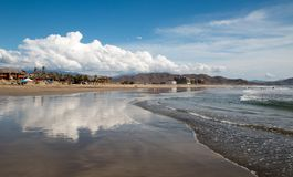 Cumulus cloud reflected at Cerritos Beach in Baja California in Mexico. BCS Royalty Free Stock Photos