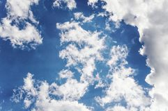 Cumulus clouds against the dark blue sky. royalty free stock images