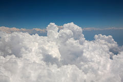 Cumulus Clouds as Seen From Aeroplane. Large White Cumulus Clouds seen from Window of Airplane Royalty Free Stock Images
