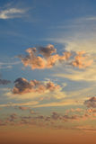 Cumulus clouds in blue and pink sky Royalty Free Stock Photo