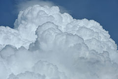 Cumulus clouds in blue sky. White puffy cumulus clouds against a blue sky Royalty Free Stock Image