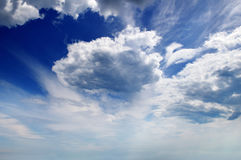 Cumulus clouds in blue sky royalty free stock image