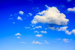 Cumulus clouds in a blue sky Stock Images