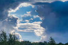 Cumulus clouds in the blue sky Stock Photos