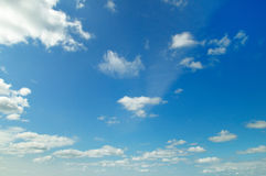 Cumulus clouds and blue sky Stock Images