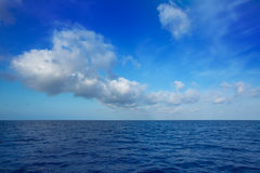 Cumulus clouds in blue sky over water horizon. Cumulus clouds in blue sky over ocean water horizon royalty free stock photos