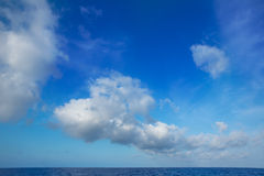 Cumulus clouds in blue sky over water horizon. Cumulus clouds in blue sky over ocean water horizon stock photography