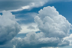 Cumulus clouds on a blue sky Stock Images