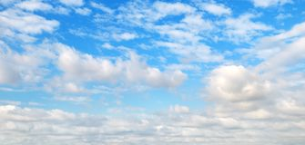 Cumulus clouds in the blue sky. Wide photo royalty free stock photo