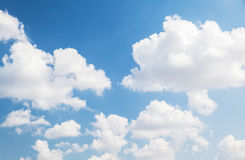 Cumulus clouds in bright blue sky, background. Cumulus clouds in bright blue sky, natural photo background Royalty Free Stock Images