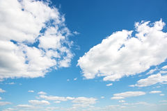 Cumulus clouds in a bright blue sky. Stock Photos