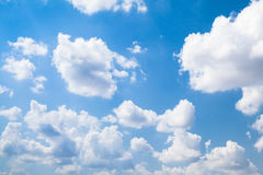 Cumulus clouds in bright blue sky at daytime. Natural background photo Stock Images