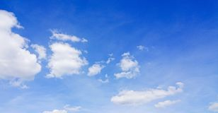 Cumulus clouds. Against a blue sky stock images