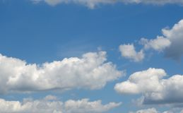 Cumulus Clouds. In a bright beautiful sunny sky. Use for a background with copy space royalty free stock image